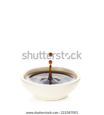 Drop of sauce on cup isolated on white - stock photo