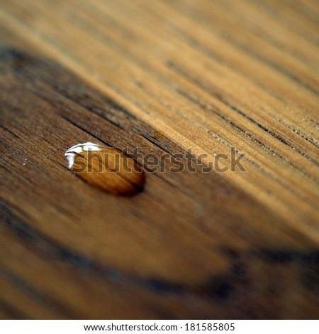 Drop of water on a wooden surface - stock photo