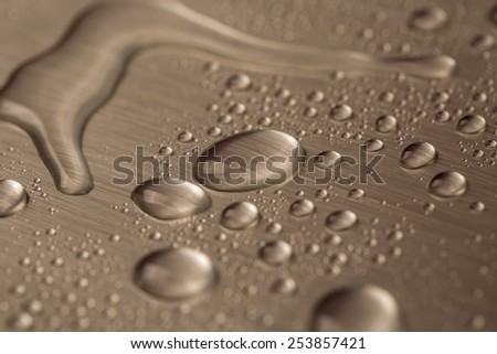 Drop of water on steel background  - stock photo