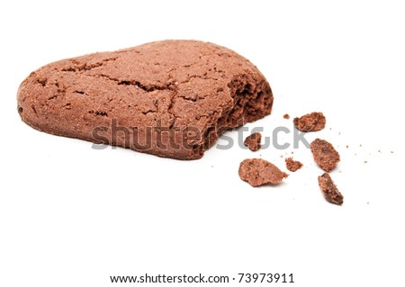 Drop shaped chocholate cookie with crumbs isolated on white