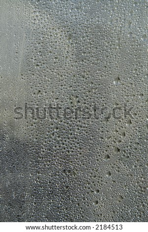 Droplets of condensation water on sheet of glass - stock photo