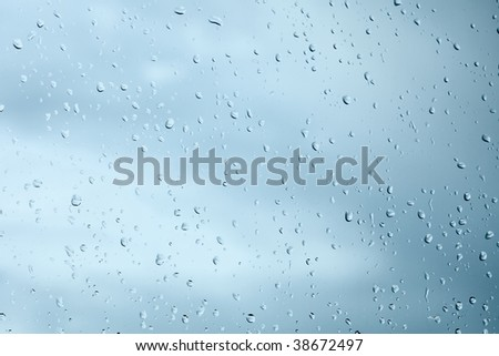 Droplets of rain water on a windowpane background