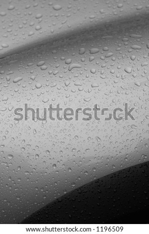 droplets on car fender - stock photo