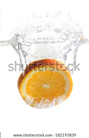 dropped orange in water isolated