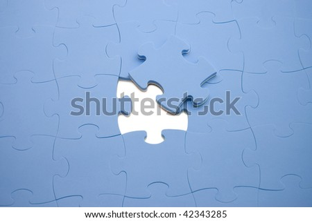 Dropped out part of a blue puzzle - stock photo