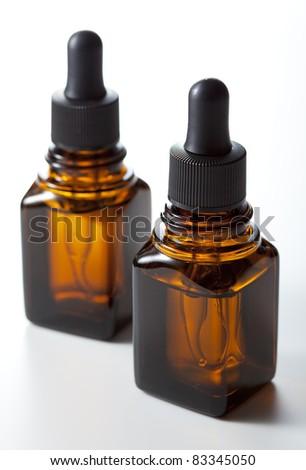 dropper bottle on white background - stock photo