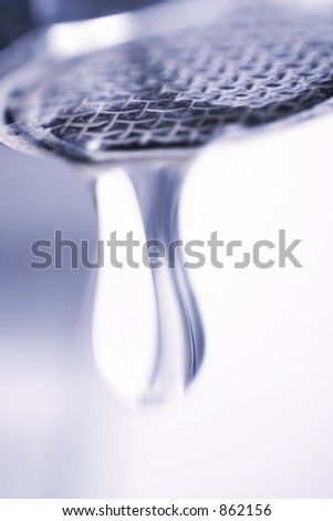 dropping faucet - stock photo