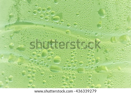 Drops background, water drops on water bottle, green color, lime color, pear color. - stock photo