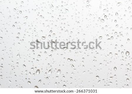 Drops of rain on a window glass - stock photo