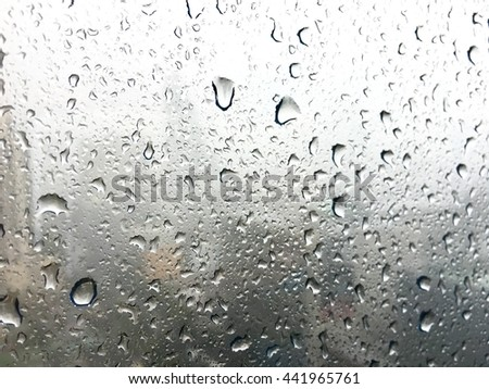 Drops of rain on a window glass.