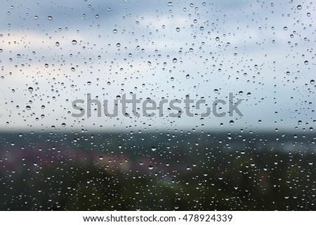 Drops of rain on a window pane.