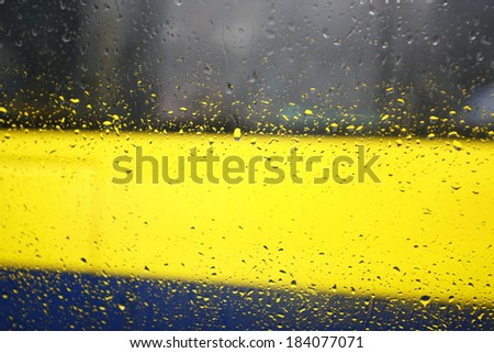 Drops of rain on a window pane and nature - stock photo
