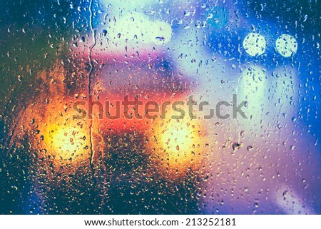 Drops Of Rain On Blue Glass Background. Street  Bokeh Lights Out Of Focus. Autumn Abstract Backdrop - stock photo