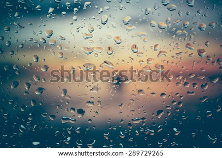 Drops of rain on glass with filter effect retro vintage style - stock photo
