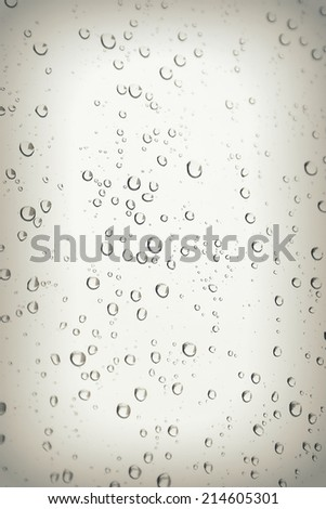 Drops of rain on the inclined window, shallow dof - stock photo