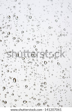 Drops of rain on the window (glass) - stock photo