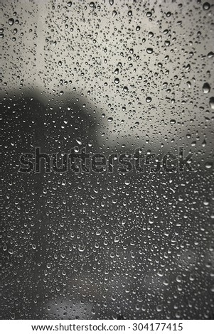 Drops of rain on the window (glass). Shallow DOF - stock photo