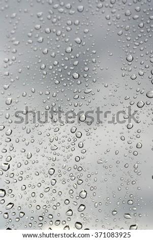 Drops of rain on the window. Shallow DOF. - stock photo