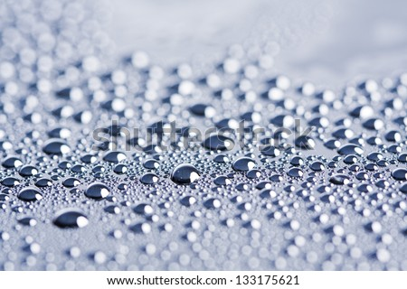 Drops of water droplets in a transparent glass on - stock photo