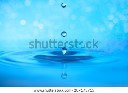 Drops of water in shades of blue - stock photo