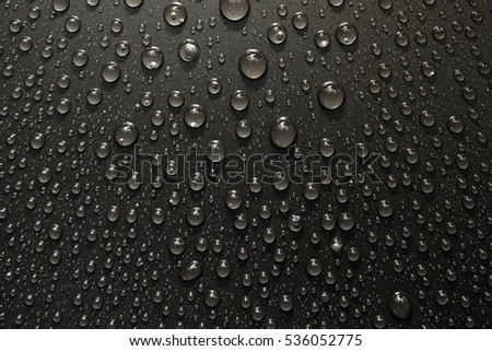 Drops of water on a black background. Macro photo texture drops.