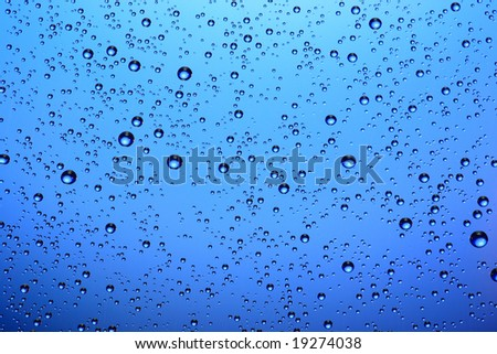 Drops of water on a blue background.