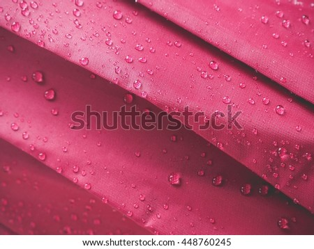 Drops of water on a cloth covering - stock photo