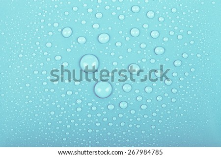 Drops of water on a color background. Blue. Shallow depth of field. Selective focus. - stock photo