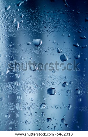 Drops of water on a glass surface.