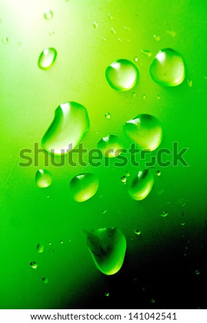 Drops of water on a green background. macro - stock photo