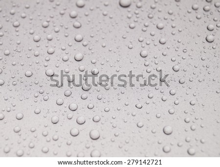 Drops of water on a luxury car - stock photo