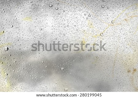 Drops of water on glass and abstract Background with bokeh defocused beautiful flowers - stock photo