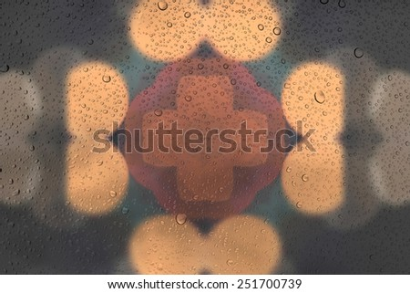 Drops of water on glass and abstract Background with bokeh,defocused light