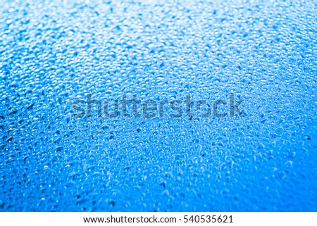 Drops of water on glass background texture