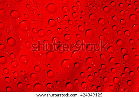 Drops of water on red background, Abstract red background - stock photo
