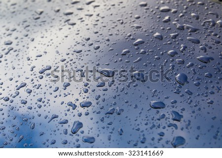 drops of water on the car after rain - stock photo