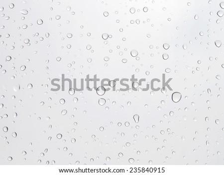 Drops of water on the floor, put a tick portfolio. - stock photo