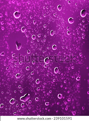 Drops of water on the glass a pink - stock photo