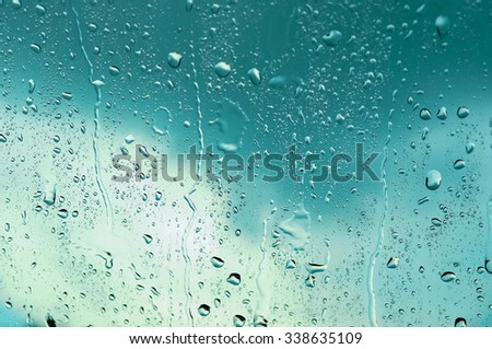 Drops of water.on the glass.and Light Blue tone background - stock photo