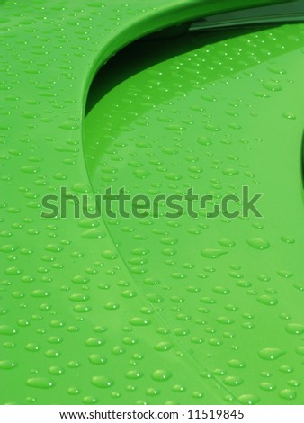 drops of water on the spoiler of a green car