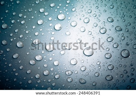 Drops of water on the surface. Shallow depth of field, unfocused - stock photo