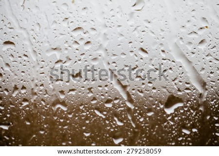 Drops on a glass surface, grey gradient