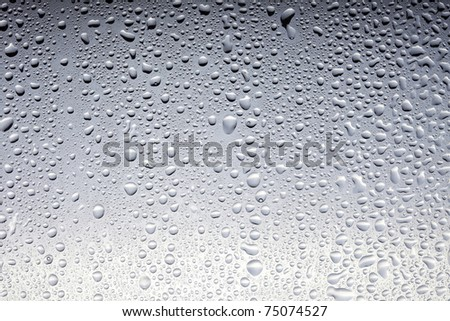 Drops on a glass surface, grey gradient - stock photo