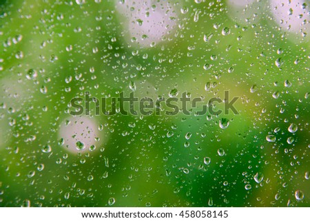 drops on a light green background, blur glass window, copy space for text. - stock photo