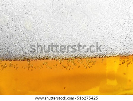 drops on glass of beer background texture. Beers bubbles