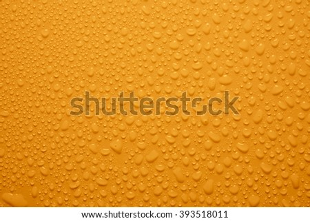 drops on yellow background - stock photo
