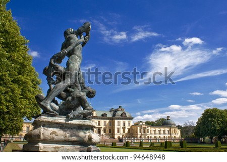 Drottningholm Palace Gardens at Stockholm, Sweden. With statue in foreground and copy space. - stock photo