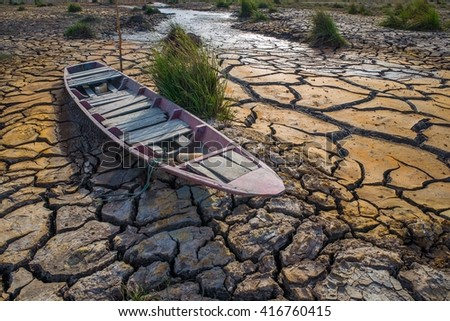 Drought and poor soil, the boat ran aground. - stock photo
