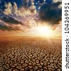 drought earth and dramatic sky - stock photo