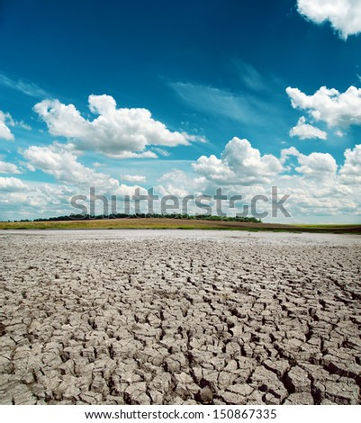 drought earth and dramatic sky over it - stock photo